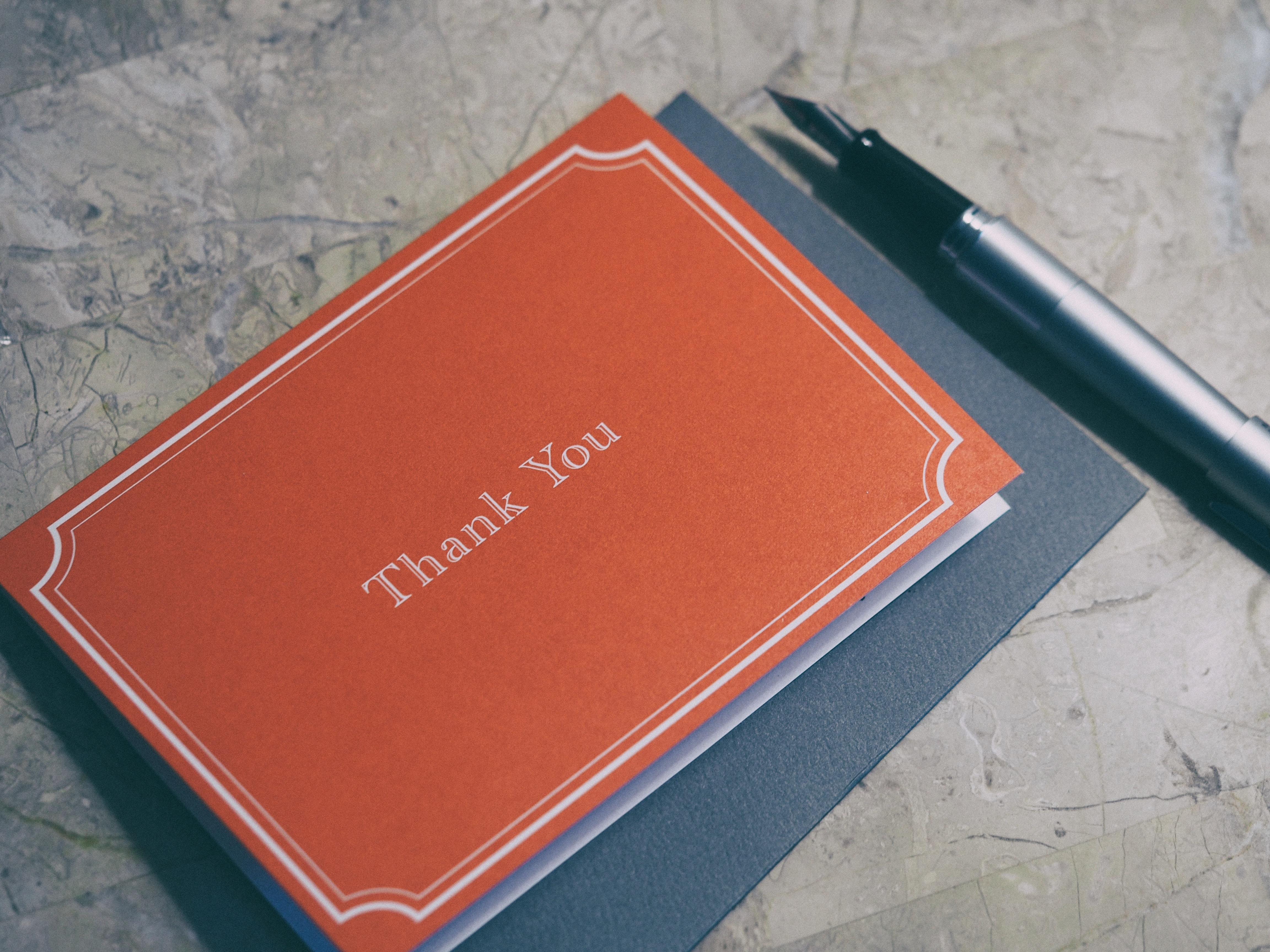Picture of a thank you card and pen
