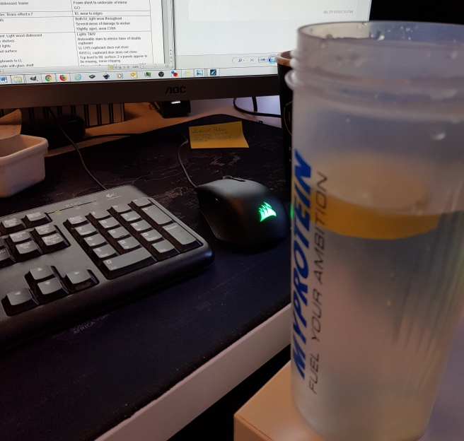 At my desk with a large cup of water
